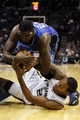 Oct 22, 2013; San Antonio, TX, USA; San Antonio Spurs forward Kawhi Leonard (bottom) and Orlando Magic forward Jason Maxiell (top) battle for the ball during the second half at AT&T Center. The Spurs won 123-101. Mandatory Credit: Soobum Im-USA TODAY Sports