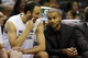 Oct 22, 2013; San Antonio, TX, USA; San Antonio Spurs guard Manu Ginobili (left) talks with Tony Parker (right) on the bench during the second half at AT&T Center. Mandatory Credit: Soobum Im-USA TODAY Sports