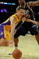 Oct 22, 2013; Los Angeles, CA, USA;  Los Angeles Lakers point guard Steve Nash (10) tries to drive past Utah Jazz power forward Derrick Favors (15) during second quarter action at Staples Center. Mandatory Credit: Robert Hanashiro-USA TODAY Sports