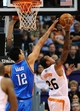 Oct 22, 2013; Phoenix, AZ, USA;Phoenix Suns guard Shannon Brown (26) lays up the ball against the Oklahoma City Thunder center Steven Adams (12) in the first half at US Airways Center. The Suns defeated the Thunder 88 to 76. Mandatory Credit: Jennifer Stewart-USA TODAY Sports