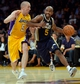 Oct 22, 2013; Los Angeles, CA, USA; Utah Jazz point guard John Lucas III (5) drives to the hoop on Los Angeles Lakers point guard Steve Blake (5) during third quarter action at Staples Center. Mandatory Credit: Robert Hanashiro-USA TODAY Sports