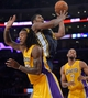 Oct 22, 2013; Los Angeles, CA, USA;  Utah Jazz power forward Derrick Favors (15) puts up a shot after getting fouled by Los Angeles Lakers center Jordan Hill (27) during third quarter action at Staples Center. Mandatory Credit: Robert Hanashiro-USA TODAY Sports