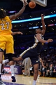 Oct 22, 2013; Los Angeles, CA, USA; Utah Jazz point guard Alec Burks (10) puts up a shot after getting fouled by Los Angeles Lakers center Jordan Hill (27) during second half action at Staples Center. Mandatory Credit: Robert Hanashiro-USA TODAY Sports