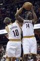Oct 19, 2013; Cleveland, OH, USA; Cleveland Cavaliers center Henry Sims (14) and Cleveland Cavaliers guard Sergey Karasev (10) during the game against the Indiana Pacers at Quicken Loans Arena. The Pacers beat the Cavaliers 102-79. Mandatory Credit: Ken Blaze-USA TODAY Sports