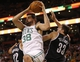 Oct 23, 2013; Boston, MA, USA; Boston Celtics center Vitor Faverani (38) grabs the rebound against Brooklyn Nets power forward Mirza Teletovic (33) and point guard Jorge Gutierrez (12) during the second half at TD Garden. The Celtics defeated the Brooklyn Nets 101-97. Mandatory Credit: David Butler II-USA TODAY Sports