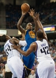Oct 23, 2013; Sacramento, CA, USA; Golden State Warriors power forward Marreese Speights (5) passes the ball over Sacramento Kings power forward Jason Thompson (34) and power forward Chuck Hayes (42) during the second quarter at Sleep Train Arena. Mandatory Credit: Ed Szczepanski-USA TODAY Sports
