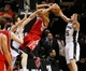 Oct 24, 2013; San Antonio, TX, USA; Houston Rockets guard Jeremy Lin (7) has his shot blocked by San Antonio Spurs guard Nando De Colo (right) during the first half at AT&T Center. Mandatory Credit: Soobum Im-USA TODAY Sports