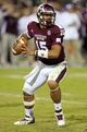 Oct 24, 2013; Starkville, MS, USA; Mississippi State Bulldogs quarterback Dak Prescott (15) drops back for a pass during the game against the Kentucky Wildcats at Davis Wade Stadium. Mandatory Credit: Spruce Derden-USA TODAY Sports