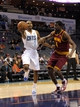 Oct 24, 2013; Charlotte, NC, USA; Charlotte Bobcats guard Ramon Sessions (7) drives past Cleveland Cavaliers guard Elliot Williams (4) during the game at Time Warner Cable Arena. The Bobcats won 102-95. Mandatory Credit: Sam Sharpe-USA TODAY Sports