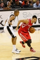 Oct 24, 2013; San Antonio, TX, USA; Houston Rockets guard Jeremy Lin (7) controls the ball under pressure by San Antonio Spurs guard Patrick Mills (8) during the second half at AT&T Center. The Rockets won 109-92. Mandatory Credit: Soobum Im-USA TODAY Sports