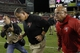 Oct 24, 2013; Tampa, FL, USA; Tampa Bay Buccaneers head coach Greg Schiano runs off the field after the loss to the Carolina Panthers at Raymond James Stadium. Carolina Panthers defeated the Tampa Bay Buccaneers 31-13. Mandatory Credit: Kim Klement-USA TODAY Sports