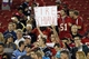 """Oct 24, 2013; Tampa, FL, USA; Tampa Bay Buccaneers fans hold up a """"Fire Schiano"""" sign at the end of the game against the Carolina Panthers at Raymond James Stadium. Carolina Panthers defeated the Tampa Bay Buccaneers 31-13. Mandatory Credit: Kim Klement-USA TODAY Sports"""