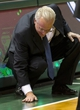 Oct 25, 2013; Milwaukee, WI, USA; Milwaukee Bucks executive vice president John Steinmiller checks the condition of the floor during the first quarter of the game against the Toronto Raptors at BMO Harris Bradley Center. Mandatory Credit: Jeff Hanisch-USA TODAY Sports