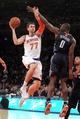 Oct 25, 2013; New York, NY, USA; New York Knicks power forward Andrea Bargnani (77) drives on Charlotte Bobcats power forward Bismack Biyombo (0) during the third quarter of a preseason game at Madison Square Garden. Mandatory Credit: Brad Penner-USA TODAY Sports