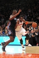 Oct 25, 2013; New York, NY, USA; New York Knicks power forward Amar'e Stoudemire (1) drives on Charlotte Bobcats power forward Bismack Biyombo (0) during the fourth quarter of a preseason game at Madison Square Garden. Mandatory Credit: Brad Penner-USA TODAY Sports
