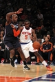 Oct 25, 2013; New York, NY, USA; New York Knicks shooting guard Tim Hardaway Jr. (5) drives on Charlotte Bobcats power forward Anthony Tolliver (43) during the fourth quarter of a preseason game at Madison Square Garden. Mandatory Credit: Brad Penner-USA TODAY Sports