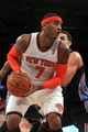 Oct 25, 2013; New York, NY, USA; New York Knicks small forward Carmelo Anthony (7) controls the ball in front of Charlotte Bobcats small forward Jeffery Taylor (44) during the fourth quarter of a preseason game at Madison Square Garden. Mandatory Credit: Brad Penner-USA TODAY Sports