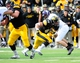 Oct 26, 2013; Iowa City, IA, USA; Iowa Hawkeyes fullback Mark Weisman (45) rushes in the first quarter against the Nothwestern Wildcats at Kinnick Stadium. Mandatory Credit: Byron Hetzler-USA TODAY Sports