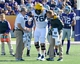 Oct 26, 2013; Manhattan, KS, USA; West Virginia Mountaineers offensive linesman Pat Eger (76) is helped of the field by medical staff after being injured on a play against the Kansas State Wildcats during the first half at Bill Snyder Family Stadium. Mandatory Credit: Jasen Vinlove-USA TODAY Sports