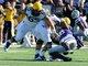 Oct 26, 2013; Manhattan, KS, USA; West Virginia Mountaineers quarterback Clint Trickett (9) is sacked by Kansas State Wildcats defensive lineman Chaquil Reed (98) during the first half at Bill Snyder Family Stadium. Mandatory Credit: Jasen Vinlove-USA TODAY Sports