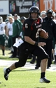 Oct 26, 2013; DeKalb, IL, USA; Northern Illinois Huskies quarterback Jordan Lynch (6) rushes the ball against Eastern Michigan Eagles defensive back Willie Creear (4) during the first half at Huskie Stadium. Mandatory Credit: Mike DiNovo-USA TODAY Sports