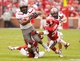 Oct 26, 2013; Norman, OK, USA; Texas Tech Red Raiders running back Kenny Williams (34) attempts to break a tackle by Oklahoma Sooners linebacker Jordan Evans (26) during the first quarter at Gaylord Family - Oklahoma Memorial Stadium. Mandatory Credit: Alonzo Adams-USA TODAY Sports