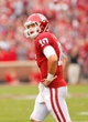 Oct 26, 2013; Norman, OK, USA; Oklahoma Sooners quarterback Blake Bell looks at the scoreboard during the first quarter against Texas Tech Red Raiders at Gaylord Family - Oklahoma Memorial Stadium. Mandatory Credit: Alonzo Adams-USA TODAY Sports