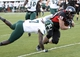Oct 26, 2013; DeKalb, IL, USA; Northern Illinois Huskies fullback Ricky Connors (48) makes a touchdown catch against Eastern Michigan Eagles defensive back Pudge Cotton (7) during the second half at Huskie Stadium. Northern Illinois defeats Eastern Michigan 59-20. Mandatory Credit: Mike DiNovo-USA TODAY Sports
