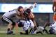 Oct 26, 2013; Blacksburg, VA, USA; Virginia Tech Hokies quarterback Logan Thomas (3) is tackled by Duke Blue Devils cornerback DeVon Edwards (27) and linebacker David Helton (47) during the third quarter at Lane Stadium. Mandatory Credit: Peter Casey-USA TODAY Sports
