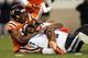 Oct 26, 2013; Blacksburg, VA, USA; Virginia Tech Hokies defensive end Dadi Nicolas (90) sacks Duke Blue Devils quarterback Anthony Boone (7) during the fourth quarter at Lane Stadium. Mandatory Credit: Peter Casey-USA TODAY Sports