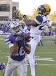 Oct 26, 2013; Manhattan, KS, USA;  Kansas State Wildcats wide receiver Tyler Lockett (16) catches a pass for a touchdown while being defended by West Virginia Mountaineers cornerback Travis Bell (26) during the second half at Bill Snyder Family Stadium. The Wildcats defeat the Mountaineers 35-12. Mandatory Credit: Jasen Vinlove-USA TODAY Sports