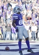 Oct 26, 2013; Manhattan, KS, USA; Kansas State Wildcats wide receiver Tramaine Thompson (86) celebrates after scoring a touchdown against the West Virginia Mountaineers during the second half at Bill Snyder Family Stadium. The Wildcats defeat the Mountaineers 35-12. Mandatory Credit: Jasen Vinlove-USA TODAY Sports