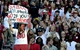Oct 26, 2013; Tuscaloosa, AL, USA; Alabama Crimson Tide fan holds a sign about fans staying in the stands if Alabama Crimson Tide head coach Nick Saban will stay as the coach at Bryant-Denny Stadium. Mandatory Credit: John David Mercer-USA TODAY Sports