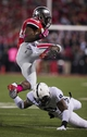 Oct 26, 2013; Columbus, OH, USA; Ohio State Buckeyes running back Carlos Hyde (34) vaults over Penn State Nittany Lions cornerback Jordan Lucas (9) at Ohio Stadium. Mandatory Credit: Greg Bartram-USA TODAY Sports