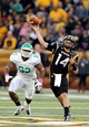 Oct 26, 2013; Hattiesburg, MS, USA; Southern Miss Golden Eagles quarterback Nick Mullens (14) throws a pass in front of North Texas Mean Green defensive end Brandon McCoy (93) in the first quarter of their game at M.M. Roberts Stadium. Mandatory Credit: Chuck Cook-USA TODAY Sports