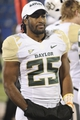 Oct 26, 2013; Lawrence, KS, USA; Baylor Bears running back Lache Seastrunk (25) stands on the sidelines against the Kansas Jayhawks in the second half at Memorial Stadium. Baylor won 59-14. Mandatory Credit: John Rieger-USA TODAY Sports