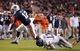 Oct 26, 2013; Auburn, AL, USA; Auburn Tigers quarterback Jonathan Wallace (12) escapes the defense of Florida Atlantic Owls safety Josh Orsino (13) at Jordan Hare Stadium. The Tigers beat the Owls 45-10. Mandatory Credit: Shanna Lockwood-USA TODAY Sports