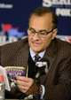 "Oct 26, 2013; St. Louis, MO, USA; MLB executive Joe Torre reads from ""Official Baseball Rules"" during a press conference after game three of the MLB baseball World Series at Busch Stadium. Cardinals won 5-4. Mandatory Credit: Jeff Curry-USA TODAY Sports"