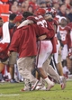 Oct 26, 2013; Norman, OK, USA; Oklahoma Sooners player Trey Millard is helped off the field after getting injured during a play against the Texas Tech Red Raiders during the fourth quarter at Gaylord Family - Oklahoma Memorial Stadium. Oklahoma won 38-30.  Mandatory Credit: Alonzo Adams-USA TODAY Sports