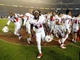 Oct 26, 2013; San Diego, CA, USA; Fresno State Bulldogs players run to celebrate with fans following a 35-28 overtime win against the San Diego State Aztecs at Qualcomm Stadium. Mandatory Credit: Christopher Hanewinckel-USA TODAY Sports