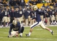 Oct 19, 2013; Pittsburgh, PA, USA; Pittsburgh Panthers kicker Chris Blewitt (12) kicks an extra point against the Old Dominion Monarchs during the fourth quarter at Heinz Field.  Pittsburgh won 35-24. Mandatory Credit: Charles LeClaire-USA TODAY Sports