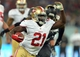 Oct 27, 2013; London, UNITED KINGDOM; San Francisco 49ers running back Frank Gore (21) runs with the ball against the Jacksonville Jaguars during an International Series game at Wembley Stadium. Mandatory Credit: Bob Martin-USA TODAY Sports