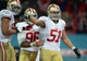 Oct 27, 2013; London, UNITED KINGDOM; San Francisco 49ers outside linebacker Dan Skuta (51) celebrates with teammates including Corey Lemonier (96) after scoring a touchdown on a fumble recovery return against the Jacksonville Jaguars in the second half during an International Series game at Wembley Stadium. Mandatory Credit: Bob Martin-USA TODAY Sports