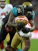 Oct 27, 2013; London, UNITED KINGDOM; San Francisco 49ers tight end Vernon Davis (85) is tackled by Jacksonville Jaguars defensive end Andre Branch (90) during an International Series game at Wembley Stadium. Mandatory Credit: Bob Martin-USA TODAY Sports