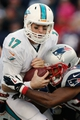 Oct 27, 2013; Foxborough, MA, USA; Miami Dolphins quarterback Ryan Tannehill (17) is sacked by New England Patriots strong safety Logan Ryan (26) during the fourth quarter of New England's 27-17 win at Gillette Stadium. Mandatory Credit: Winslow Townson-USA TODAY Sports