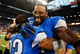 Oct 27, 2013; Detroit, MI, USA; Detroit Lions wide receiver Calvin Johnson (81) celebrates with cornerback Chris Houston (23) after defeating the Dallas Cowboys 31-30 at Ford Field. Mandatory Credit: Andrew Weber-USA TODAY Sports
