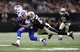Oct 27, 2013; New Orleans, LA, USA; Buffalo Bills wide receiver Steve Johnson (13) is tackled by New Orleans Saints outside linebacker David Hawthorne (57) during the second half at Mercedes-Benz Superdome. New Orleans defeated Buffalo 35-17. Mandatory Credit: Crystal LoGiudice-USA TODAY Sports