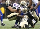 Oct 27, 2013; New Orleans, LA, USA; New Orleans Saints defensive end Akiem Hicks (76) and other defenders tackle Buffalo Bills running back Tashard Choice (20) during the second half at Mercedes-Benz Superdome. New Orleans defeated Buffalo 35-17. Mandatory Credit: Crystal LoGiudice-USA TODAY Sports