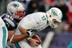 Oct 27, 2013; Foxborough, MA, USA; New England Patriots defensive end Rob Ninkovich (50) sacks Miami Dolphins quarterback Ryan Tannehill (17) during the fourth quarter of their 27-17 win at Gillette Stadium. Mandatory Credit: Winslow Townson-USA TODAY Sports