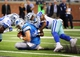 Oct 27, 2013; Detroit, MI, USA; Detroit Lions quarterback Matthew Stafford (9)  slides near the goal line during 2nd half of a game at Ford Field. Lions won 31-30. Mandatory Credit: Mike Carter-USA TODAY Sports
